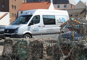 The Mobile Therapy Room in among the lobster pots at Dunbar Harbour