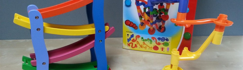 A click clack track and a marble run