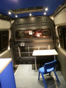 The mobile therapy room with the LED lights on in the dark.
